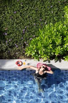 Woman in bikini at pool side