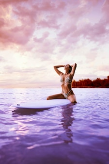 Woman in bikini surfing with vaporwave style