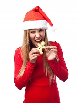 Woman biting a cookie