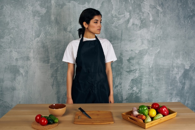 Woman in black apron cooking healthy eating
