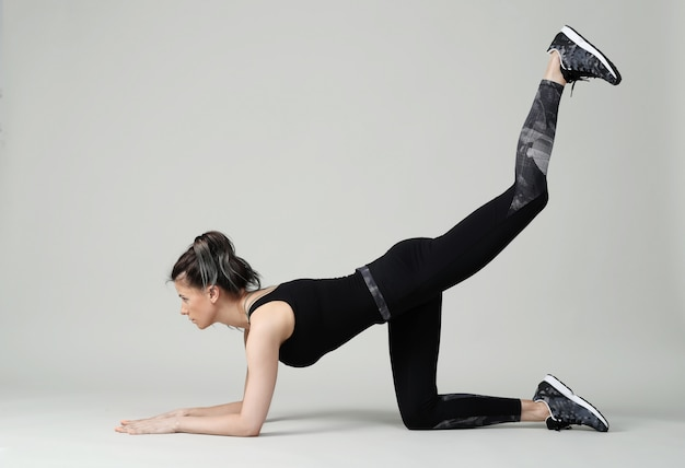 Woman in black clothes working out