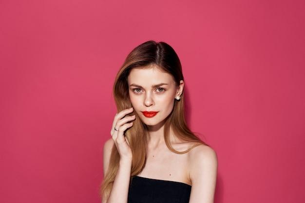 Woman in black dress red lips glamor pink glamor