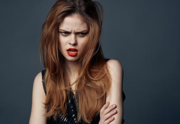 Woman in black dress red lips posing glamor model. high quality photo