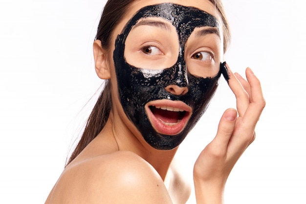 Woman in black face cleansing mask
