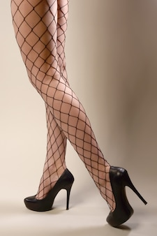 Woman in black fishnet tights and high heels