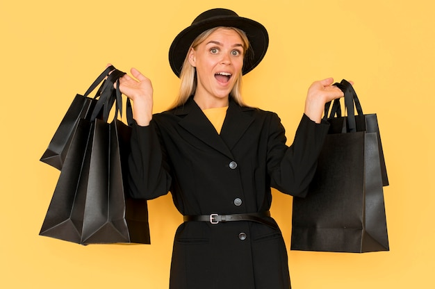Woman on black friday sale holding shopping black bags
