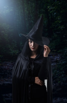 Woman in black scary witch halloween costume