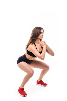 Woman in black sportswear does exercises for strong figure body