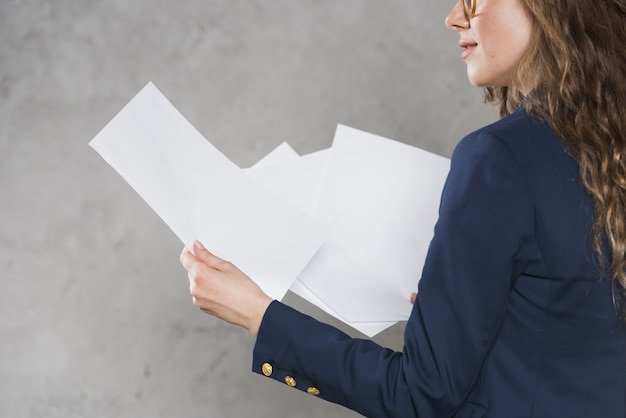 Woman in blazer holding papers