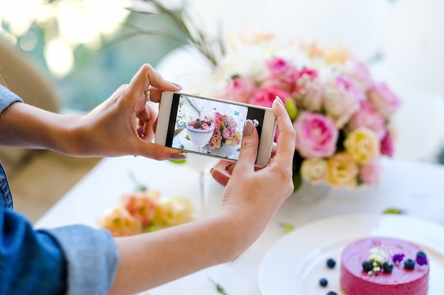 Woman blogger smartphone photo party pastries