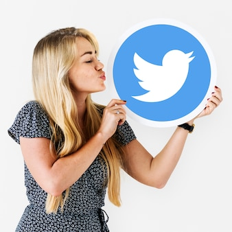 Woman blowing a kiss to a twitter icon