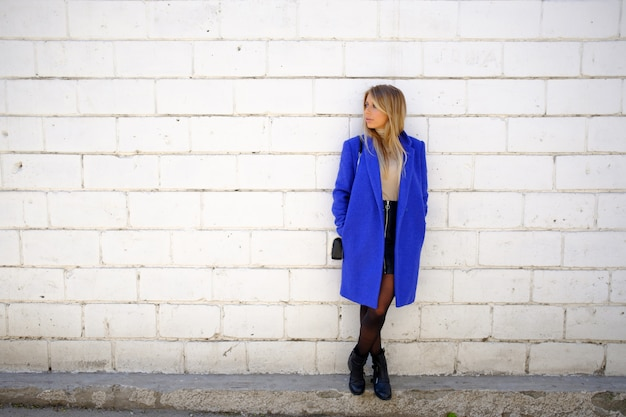 Woman in the blue coat on the street