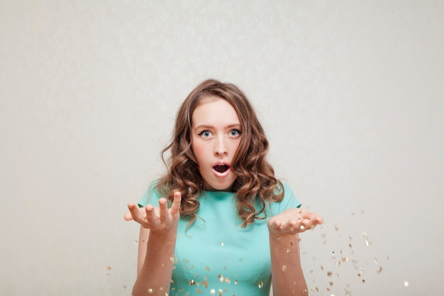 Woman in blue dress looking surprised