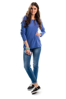 Woman in blue pullover smiling. girl in jeans with phone. casual outfit and modern gadget. go with the times.