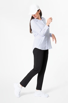 Woman in blue shirt and pants with hat casual wear fashion full body