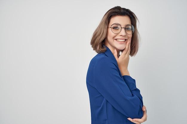 Woman in blue shirt wearing glasses fashion elegant posing style. high quality photo