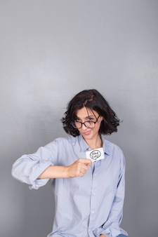 Woman in blue shirt with credit card