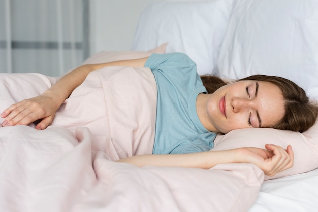 Woman in blue tshirt sleeping