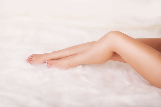 Woman body care. close up of long female legs with perfect smooth soft skin.
