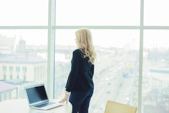 Woman boss style working in an office on a laptop hands