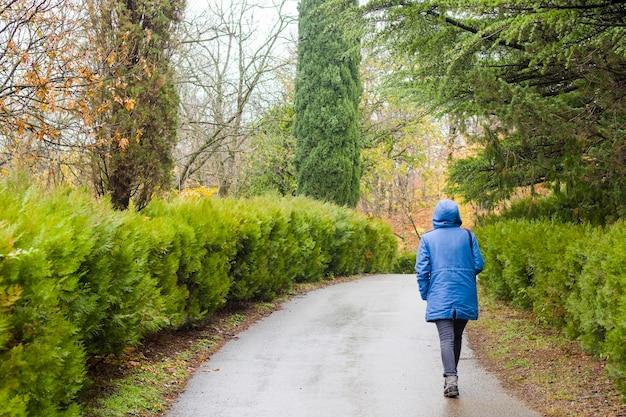Woman in the botanic garden and park Premium Photo