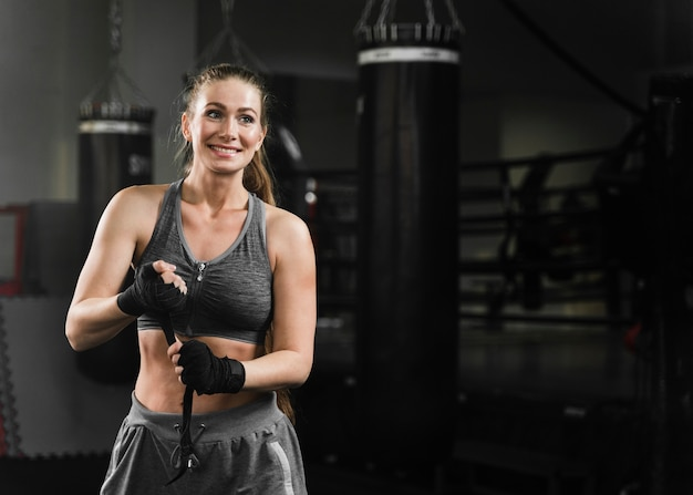 Woman boxer getting ready for training with copy space