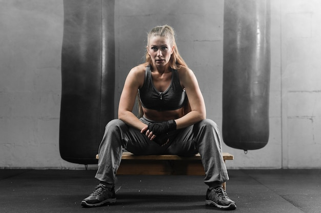 Woman boxer taking a break from training