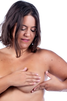 Woman breast self care and examination for lumps or weird symptoms.
