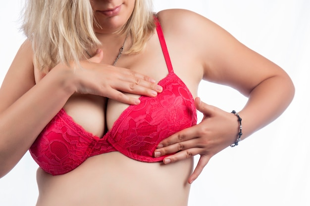 Woman breast self care and examination for lumps or weird symptoms