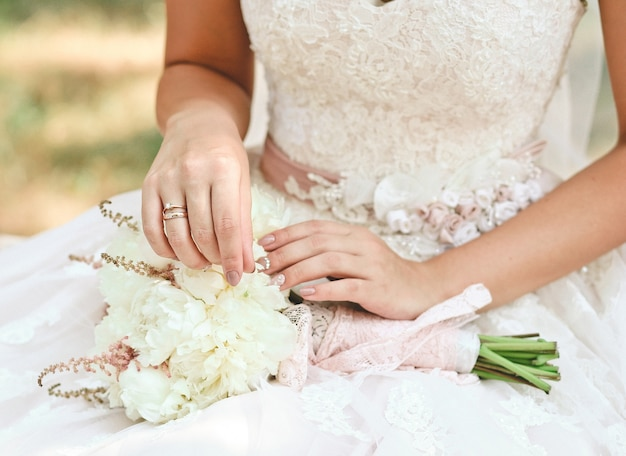 Woman bride holding a beautiful bouquet of flowers