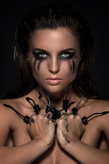 Woman and broken mascara brushes