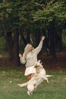 Woman in a brown sweater. lady with a labrador