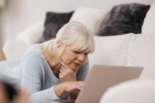 Woman browsing laptop and thinking Free Photo
