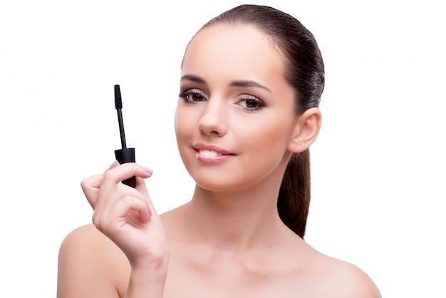 Woman brushing eyelashes isolated on white