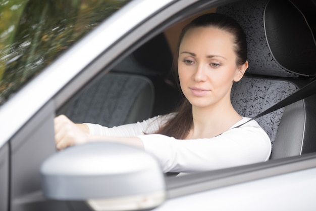 Woman buckling a seat belt