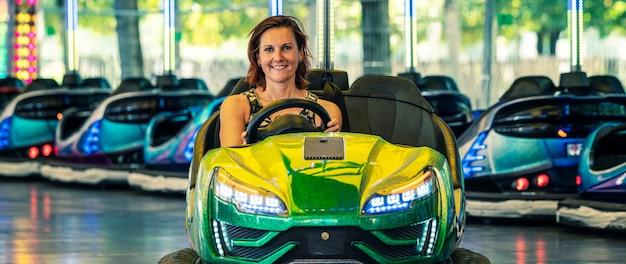 Woman in a bumper car, paris, france