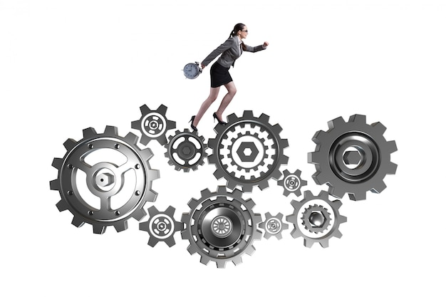 Woman businesswoman walking in cogwheels isolated on white