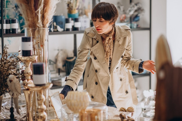 Woman buying stuff in a decoration store