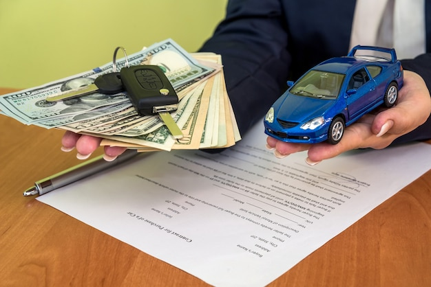 Woman buys a car signing a contract