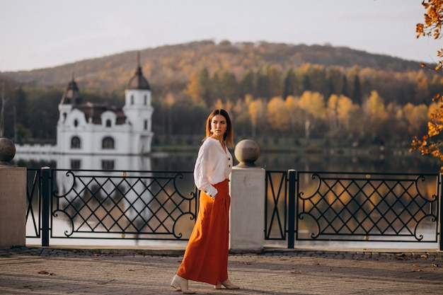Woman by the castle and lake posing