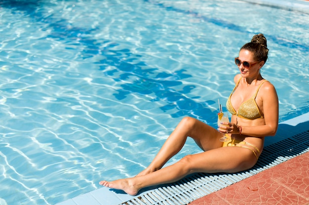 Woman by the pool in summer