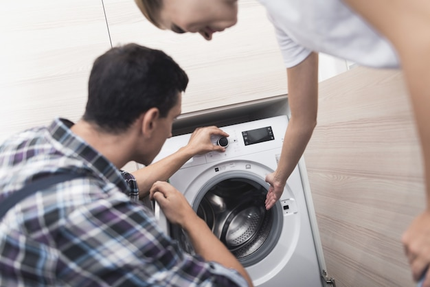 Woman called the repairman of the washing machine.