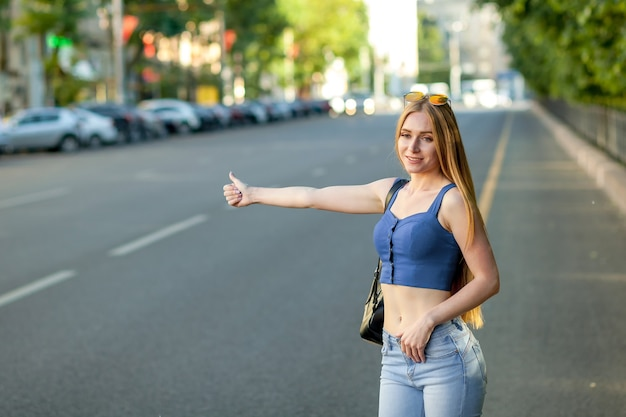 Woman calling a taxi