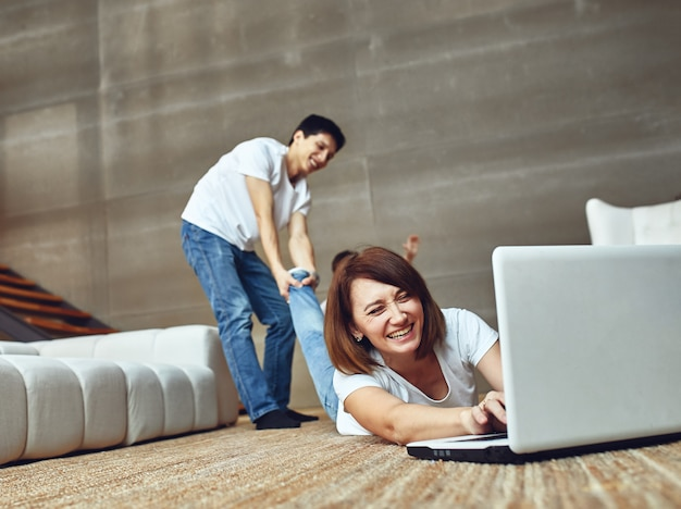 A woman cannot tear herself away from the computer.