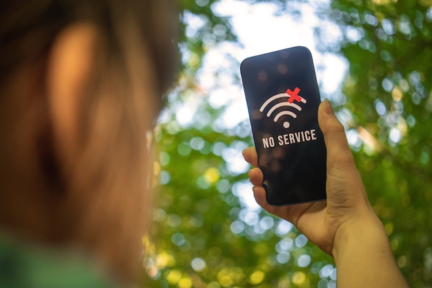 Woman cant find any mobile phone coverage in the forest