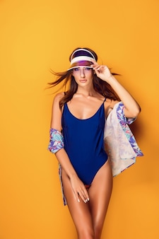 Woman in cap and swimwear