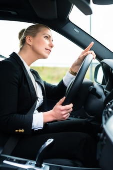 Woman in car being angry cursing other driver