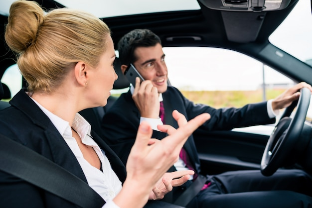 Woman in car being angry at phoning man