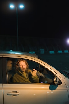Woman in car at nicht