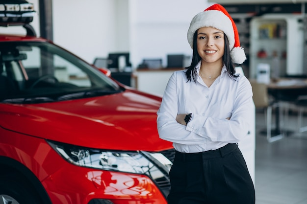 Woman in a car showroom on christmas
